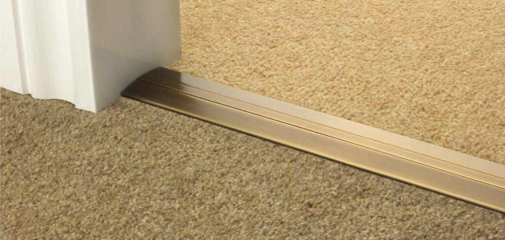 Posh door carpet plate between two carpets
