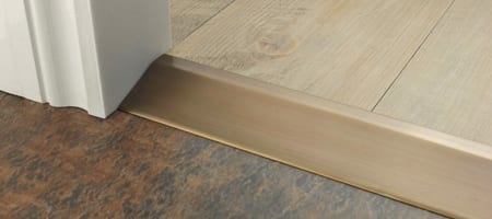Premier Ramp antique brass ramp from wood to LVT