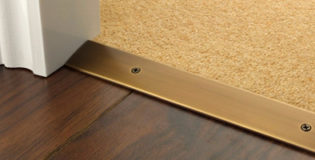 How to install a door threshold between rooms for beginners