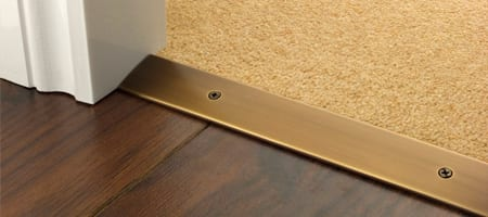 Premier Cover plate with matching screws in antique bronze joining carpet to wood