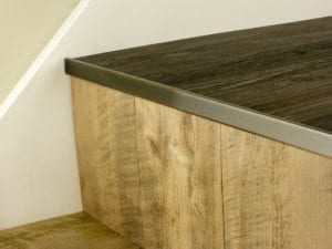 LVT Nosing No Bull fitted on vinyl covered step in antique bronze