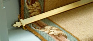 Royale Beamont design of triangular stair rod in polished brass for runner stair carpets