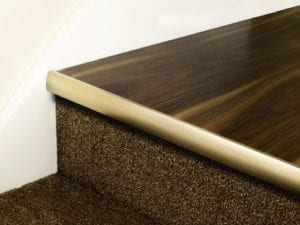 Stair nosing strip in antique brass with rounded profile