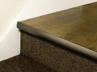 LVT Stair Nosing Full Bull strip fitted on front of step in antique bronze with rounded profile