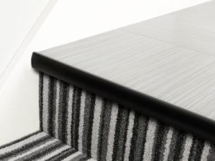 LVT Stair Nosing Full Bull strip along front of step in black with rounded profile