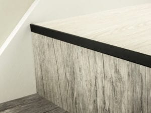 LVT Nosing No Bull fitted on vinyl covered step in black