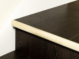 Stair nosing strip in satin brass with rounded profile