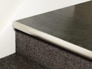 Vinyl stair nosing strip in satin nickel