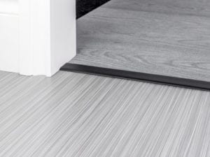 Join carpet to carpet with door thresholds in black