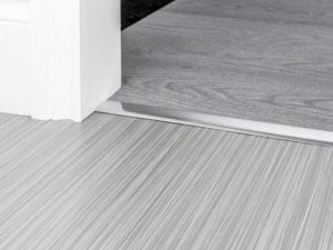 Brushed chhroem door thresholds for joining carpets and hard flooring