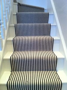 Black and white striped stair runner decorated with chrome Easy studs on each step