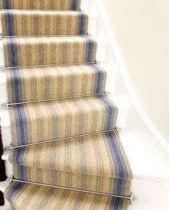 Blue striped staircase fitted with Sherwood stair rods in chrome