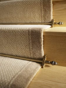 Dubai design of carpet rods in antique brass, fitted on beige carpet runner