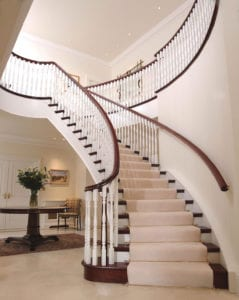 Dubai stair carpet rods on grand winding staircase with cream carpet