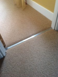 Feline 2 luxury door threshold in nisheen finish, joins carpet to carpet