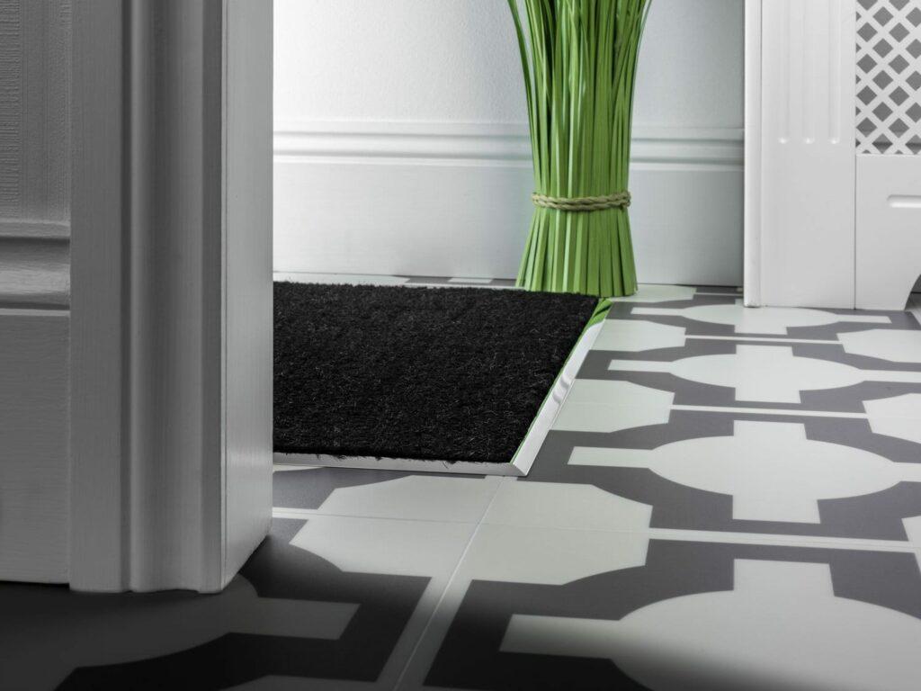 metal mat well frame in brushed chrome installed on tiled hall floor