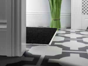metal edging to create a mat well in satin nickel finish installed on tiled hall floor
