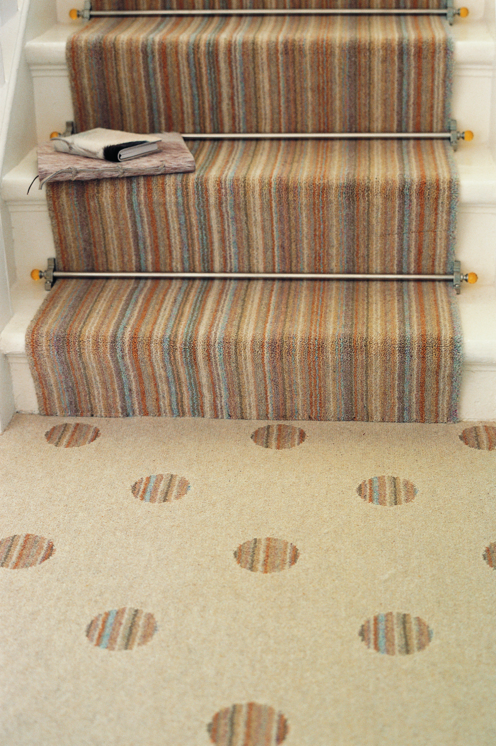 Amber Crystal stair rods fitted on striped runner stair carpet