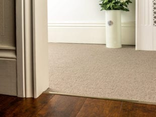 Premier Slim z bar joining a beige carpet to wood tiles, slim, antique brass