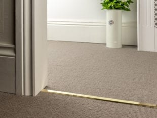 Double Z bar for joining carpets in polished brass