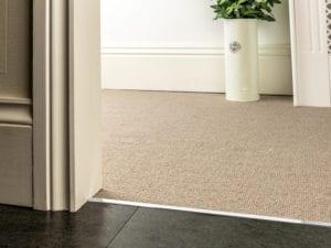Premier Slim z bar joining a beige carpet to wood tiles, slim, chrome