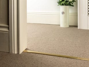 Premier Slim D door bar joining 2 beige carpets in satin brass extra narrow