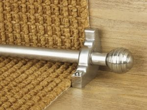 Sphere brushed chrome stair-rod for a runner carpet