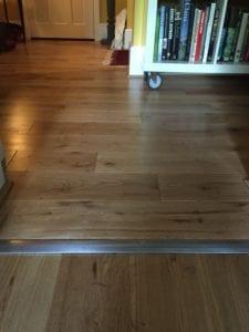 Premier Posh room dividing strip between wood floors