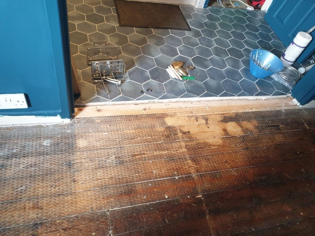 Transition between different floor levels such as thick tiles to floorboards