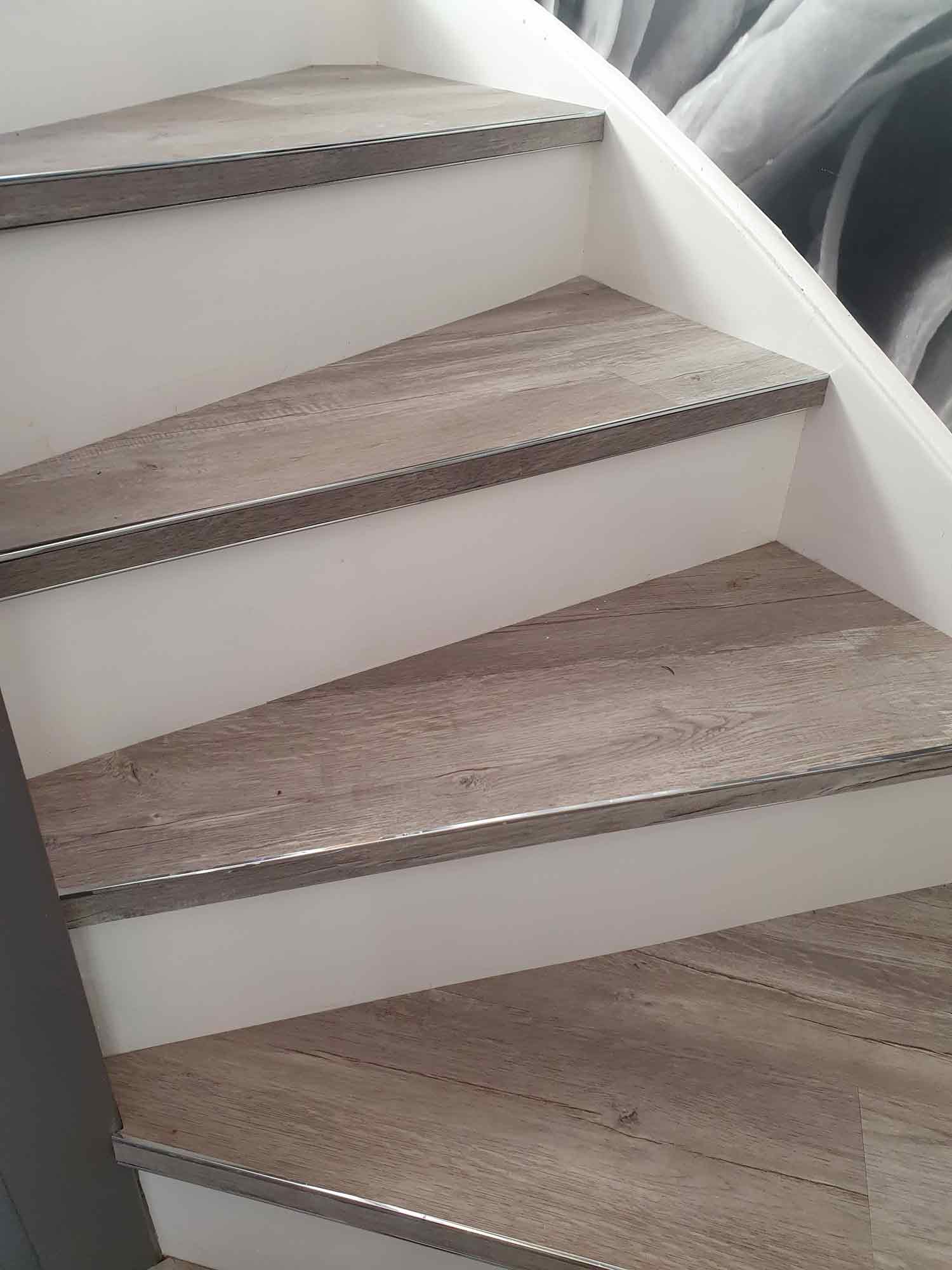 Premier bendy bull stair edge fitted to winding staircase fitted with wood-look LVT