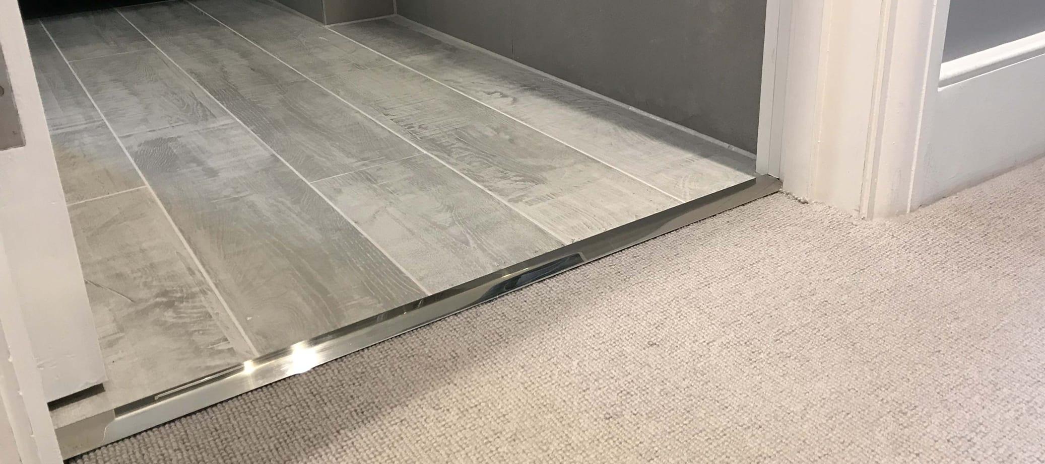 Button to carpet to lino door threshold in satin nickel