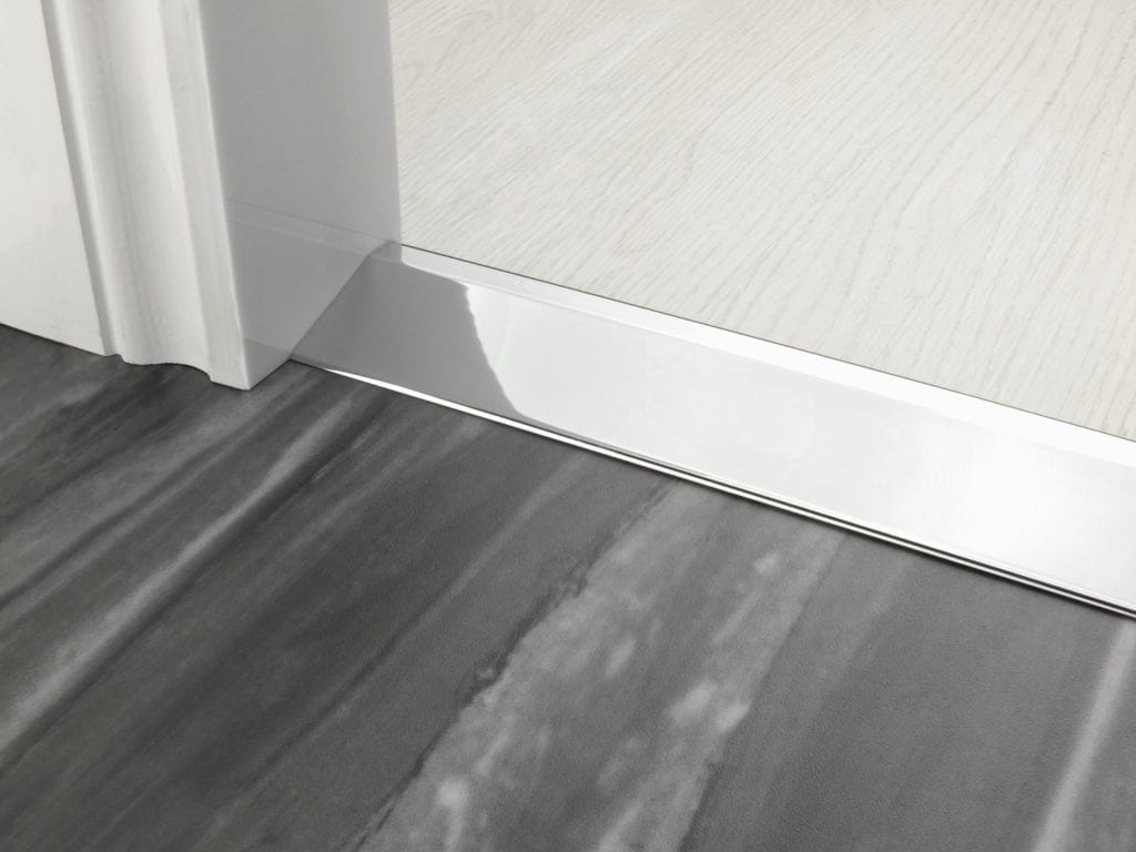 Uneven door thresholds 20mm Ramp in chrome joining wood and LVT