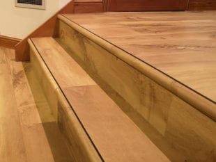 Stair nosing in black with matching LVT