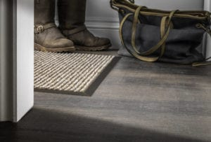 Matwell frame in antique bronze on a floating laminate floor
