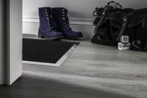 Matwell frame in brushed-chrome on a floating laminate floor