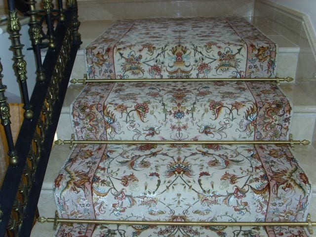 Dubai design stair rods in brass fitted on a wide floralstair runner