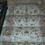 Polished brass stair rods on staircase