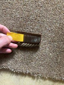 Self-adhesive strip on reverse of Easybind mat edging