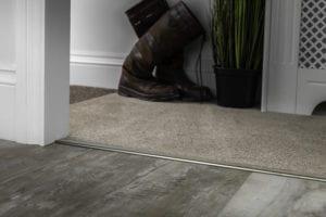 Ali Tramline z carpet thresholds in antique brass joins LVT to carpet