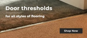 Carpet door barbetween brown tufted carpet and beige loop pile carpet