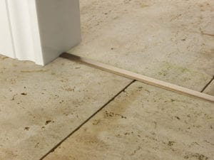 T bar in antique brass finish on stone floor