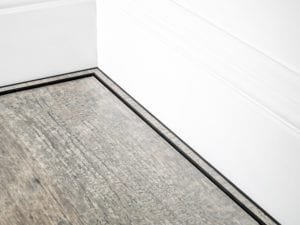 scotia moulding in black attached to skirting board