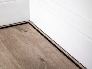 scotia laminate beading i black attached to skirting board