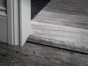 Black reducer profile for uneven vinyl floors