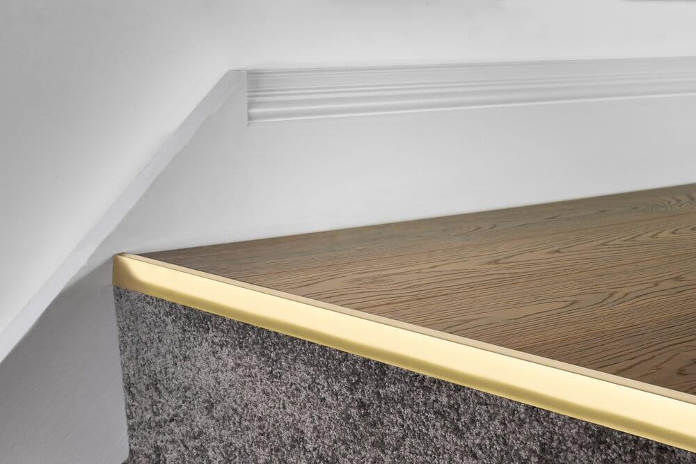Ali Top Nose stair nose for laminates brass nosing fixed to step