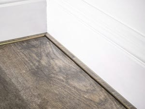 scotia beading 5mm in antique brass attached to skirting board