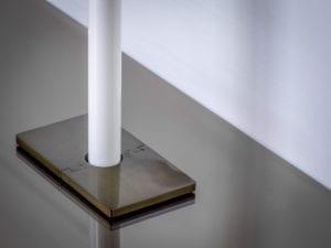 radiator pipe collar in rectangle shape around pipe antique bronze