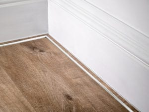 scotia trim in chrome shown attached to skirting board