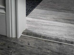 Reducer transition in chrome for joining laminate or vinyl floors