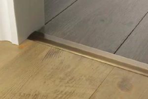 Posh door threshold joining vinyl to porcelain tiles antqieu brass